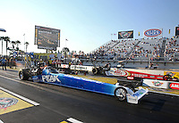 Mar. 15, 2013; Gainesville, FL, USA; NHRA top fuel dragster driver T.J. Zizzo (near lane) races alongside Doug Kalitta during qualifying for the Gatornationals at Auto-Plus Raceway at Gainesville. Mandatory Credit: Mark J. Rebilas-