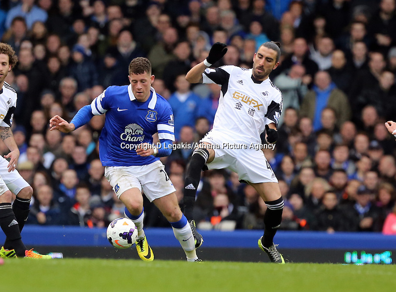 Pictured L-R: Ross Barkley of Everton is challenged by Chico Flores of Swansea. Saturday 22 March 2014<br /> Re: Barclay's Premier League, Everton v Swansea City FC at Goodison Park, Liverpool, UK.