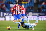Facundo Roncaglia (r) of RC Celta de Vigo is tripped as he competes for the ball with Fernando Torres of Atletico de Madrid during their La Liga match between Atletico de Madrid and RC Celta de Vigo at the Vicente Calderón Stadium on 12 February 2017 in Madrid, Spain. Photo by Diego Gonzalez Souto / Power Sport Images