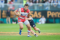 20120803 Copyright onEdition 2012©.Free for editorial use image, please credit: onEdition..Gareth Evans of Gloucester Rugby is tackled by Tom Cruse of Sale Sharks at The Recreation Ground, Bath in the Final round of The J.P. Morgan Asset Management Premiership Rugby 7s Series...The J.P. Morgan Asset Management Premiership Rugby 7s Series kicked off again for the third season on Friday 13th July at The Stoop, Twickenham with Pool B being played at Edgeley Park, Stockport on Friday, 20th July, Pool C at Kingsholm Gloucester on Thursday, 26th July and the Final being played at The Recreation Ground, Bath on Friday 3rd August. The innovative tournament, which involves all 12 Premiership Rugby clubs, offers a fantastic platform for some of the country's finest young athletes to be exposed to the excitement, pressures and skills required to compete at an elite level...The 12 Premiership Rugby clubs are divided into three groups for the tournament, with the winner and runner up of each regional event going through to the Final. There are six games each evening, with each match consisting of two 7 minute halves with a 2 minute break at half time...For additional images please go to: http://www.w-w-i.com/jp_morgan_premiership_sevens/..For press contacts contact: Beth Begg at brandRapport on D: +44 (0)20 7932 5813 M: +44 (0)7900 88231 E: BBegg@brand-rapport.com..If you require a higher resolution image or you have any other onEdition photographic enquiries, please contact onEdition on 0845 900 2 900 or email info@onEdition.com.This image is copyright the onEdition 2012©..This image has been supplied by onEdition and must be credited onEdition. The author is asserting his full Moral rights in relation to the publication of this image. Rights for onward transmission of any image or file is not granted or implied. Changing or deleting Copyright information is illegal as specified in the Copyright, Design and Patents Act 1988. If you are in any way unsure of your right to publish