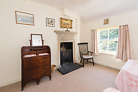 BNPS.co.uk (01202) 558833. <br /> Pic: TimHardy/KnightFrank/BNPS<br /> <br /> Pictured: Bedroom. <br /> <br /> A traditional country cottage in a hidden valley surrounded by its own woodland is on the market for offers over £700,000.<br /> <br /> Beck Cottage sits in a stunning position with a stream that has fishing rights and an idyllic private natural pool with a waterfall.<br /> <br /> Estate agent Knight Frank say it is a rare opportunity for someone to get their own bit of unspoilt England as the cottage is on the market for the first time in about 70 years.<br /> <br /> The five-bedroom property is close to the seaside town of Whitby and the North York Moors National Park.