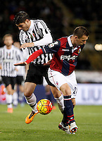 Calcio, Serie A:  Bologna vs Juventus. Bologna, stadio Renato Dall'Ara, 19 febbraio 2016. <br /> Juventus' Alvaro Morata, left, and Bologna's Daniele Gastaldello fight for the ball during the Italian Serie A football match between Bologna and Juventus at Bologna's Renato Dall'Ara stadium, 19 February 2016.<br /> UPDATE IMAGES PRESS/Isabella Bonotto
