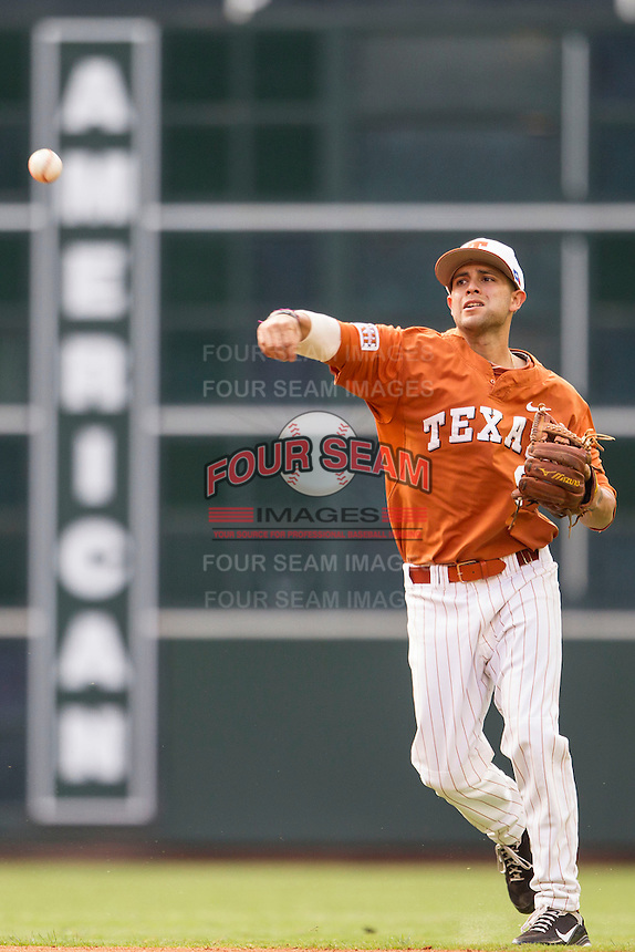 Texas Longhorns shortstop CJ Hinojosa #9 makes a throw to first base during the NCAA baseball game against the Houston Cougars on March 1, 2014 during the Houston College Classic at Minute Maid Park in Houston, Texas. The Longhorns defeated the Cougars 3-2. (Andrew Woolley/Four Seam Images)