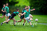 Milltown Castlemaine's Eoin O'Brien takes his shot despite the pressure from Paul Linehan and Peadar Stack of Churchill in the Senior football league division 3 promotion play off.