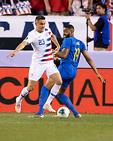 PHILADELPHIA, PA - JUNE 30: Aaron Long #23 takes the ball from Jafar Arias #19 during a game between Curaçao and USMNT at Lincoln Financial Field on June 30, 2019 in Philadelphia, Pennsylvania.