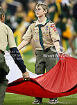 A Boy Scout helps with the pre-game ceremonies during the 2010 Texas  Bowl football game between the Illinois  Fighting Illini and the Baylor Bears at the Reliant Stadium in Houston, Tx. Illinois defeats Baylor 38 to 14....