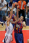Real Madrid's Ante Tomic (l) and FC Barcelona's Fran Vazquez during ACB Supercup Semifinal match.September 24,2010. (ALTERPHOTOS/Acero)