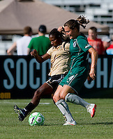 FC Gold Pride midfielder Formiga (31) and Saint Louis Athletica defender Kendall Fletcher (24) during a WPS match at Anheuser-Busch Soccer Park, in St. Louis, MO, July 26, 2009.  The match ended in a 1-1 tie.