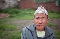 A Nepali man poses for portrait at Pashupati Nath temple in Kathmandu, Nepal