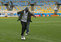Artist Wyclef Jean has a kick about on the Maracana pitch ahead of tomorrow's FIFA World Cup final Germany vs Argentina where he will perform during the closing ceremony