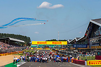18th July 2021; Silverstone Circuit, Silverstone, Northamptonshire, England; Formula One British Grand Prix, Race Day; The Red Arrows streak over the starting grid