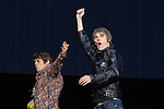 © Joel Goodman - 07973 332324 . 30/06/2012 . Manchester , UK . IAN BROWN (right) and MANI (left) ( Gary Manny Mounfield ) enter stage at the start of the Stone Roses Second Coming reunion gig at Heaton park in North Manchester . Photo credit : Joel Goodman