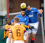 17.01.2021 Motherwell v Rangers: Leon Balogun and Connor Goldson compete for the same ball