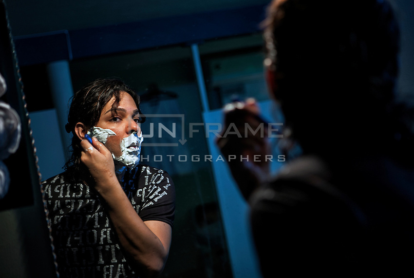 Ali Saleem shaves as he prepares for his performance in the upcoming show.