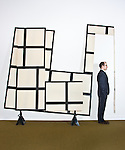 "Miami Art Museum director Thom Collins photographed at MAM with Eugenio Espinosa's ""Otro Geometrico""."