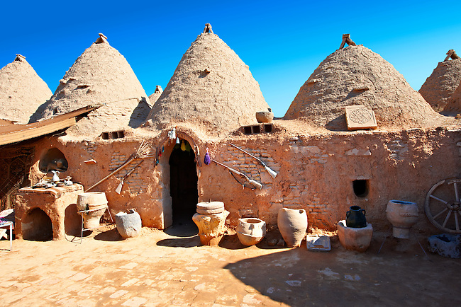 """Pictures of the beehive adobe buildings of Harran, south west Anatolia, Turkey.  Harran was a major ancient city in Upper Mesopotamia whose site is near the modern village of Altınbaşak, Turkey, 24 miles (44 kilometers) southeast of Şanlıurfa. The location is in a district of Şanlıurfa Province that is also named """"Harran"""". Harran is famous for its traditional 'beehive' adobe houses, constructed entirely without wood. The design of these makes them cool inside. 18"""