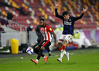 7th November 2020; Brentford Community Stadium, London, England; English Football League Championship Football, Brentford FC versus Middlesbrough; Marvin Johnson of Middlesbrough marking Rico Henry of Brentford