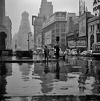 Times Square on a rainy day. New York, New York. March 1943.<br /> <br /> Photo by John Vachon.