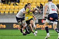 Wes Goosen of the Hurricanes is tackled during the Super Rugby - Hurricanes v Rebels at Sky Stadium, Wellington, New Zealand on Friday 21 May 2021.<br /> Photo by Masanori Udagawa. <br /> www.photowellington.photoshelter.com