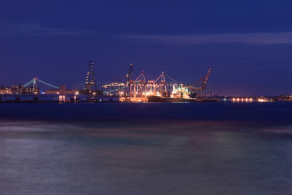 Container Ship Being Loaded at Dock at Night, Brooklyn, New York City, New York State, USA