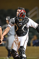 Salt River Rafters catcher/infielder Peter O'Brien (34) throws down to second in between innings during an Arizona Fall League game against the Peoria Javelinas on October 17, 2014 at Salt River Fields at Talking Stick in Scottsdale, Arizona.  The game ended in a 3-3 tie.  (Mike Janes/Four Seam Images)
