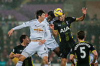Sunday  14th   December 2014 <br /> Pictured: Ki Sung-Yueng of Swansea City and Wilfried Bony of Swansea City jump for the ball <br /> Re: Barclays Premier League Swansea City v Tottenham Hotspur  at the Liberty Stadium, Swansea, Wales,UK