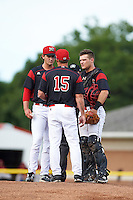 Batavia Muckdogs pitching coach Chad Rhoades (15) talks with starting pitcher Ryan McKay (27) and catcher Jarett Rindfleisch (44) during the first game of a doubleheader against the Mahoning Valley Scrappers on August 17, 2016 at Dwyer Stadium in Batavia, New York.  Mahoning Valley defeated Batavia 10-3. (Mike Janes/Four Seam Images)