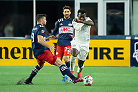 FOXBOROUGH, MA - MAY 1: Matt Polster #8 of New England Revolution comes in to intercept George Bello #21 of Atlanta United FC during a game between Atlanta United FC and New England Revolution at Gillette Stadium on May 1, 2021 in Foxborough, Massachusetts.