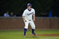 Trevor Jones (40) of the Western Carolina Catamounts takes his lead off of third base against the St. John's Red Storm at Childress Field on March 13, 2021 in Cullowhee, North Carolina. (Brian Westerholt/Four Seam Images)