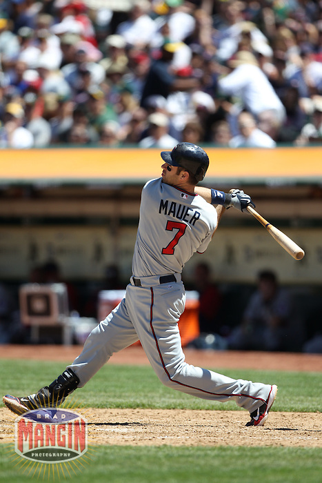 OAKLAND, CA - JUNE 6:  Joe Mauer #7 of the Minnesota Twins bats during the game against the Oakland Athletics at the Oakland-Alameda County Coliseum on June 6, 2010 in Oakland, California. Photo by Brad Mangin