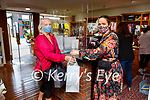 Frances Griffin left checking out the new styles with the help of Barbara Coleman  in Lynes of Killarney after it reopened on Monday