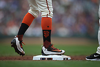 SAN FRANCISCO, CA - AUGUST 9:  Detail of Denard Span #2 of the San Francisco Giants standing on first base  wearing Nike cleats against the Chicago Cubs during the game at AT&T Park on Wednesday, August 9, 2017 in San Francisco, California. (Photo by Brad Mangin)
