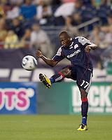New England Revolution midfielder Sainey Nyassi (17) volleys ball forward. The New England Revolution defeated Houston Dynamo, 1-0, at Gillette Stadium on August 14, 2010.