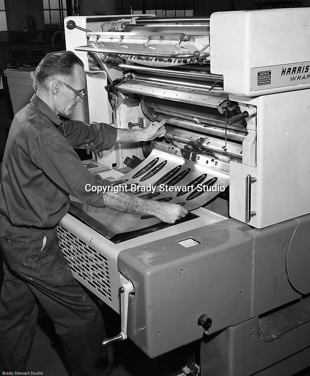 Pittsburgh PA - View of a printing press operator creating a printing plate using the Harris printing equipment.  On-site photography at Colonial Press Company at the Try Street Terminal Building.<br /> Colonial Press merged with Herbick and Held Printers in 1958 and operated as a division. During the 1980's hard times hit the city and business printers; Herbick and Held closed in 1984.