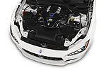 Car Stock 2014 Maserati Ghibli Base 4 Door Sedan Engine high angle detail view