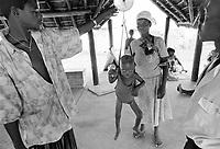 - Mozambique 1993, country hospital in Nhamatanda village, province of Sofala, weigh of a child for malnutrition control<br /> <br /> - Mozambico 1993, ospedale rurale nel villaggio di Nhamatanda, provincia di Sofala, pesatura di un bambino per controllo della denutrizione