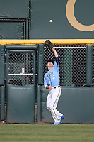 Hunt Mercado-Hood (5) of the University of San Diego Toreros catches a ball near the outfield wall during a game against the UCLA Bruins at Jackie Robinson Stadium on March 4, 2017 in Los Angeles, California.  USD defeated UCLA, 3-1. (Larry Goren/Four Seam Images)