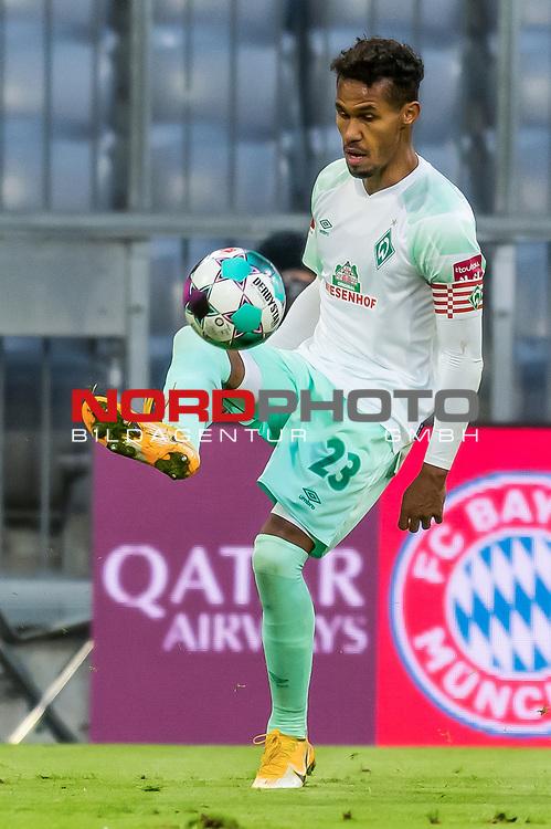 21.11.2020, Allianz Arena, Muenchen, GER,  FC Bayern Muenchen SV Werder Bremen <br /> <br /> <br />  im Bild Theodor Gebre Selassie (SV Werder Bremen #23) <br /> <br />  ,Ball am Fuss, Hochformat Einzelaktion, Ganzkörper / Ganzkoerper <br /> <br /> Foto © nordphoto / Straubmeier / Pool/ <br /> <br /> DFL regulations prohibit any use of photographs as image sequences and / or quasi-video.