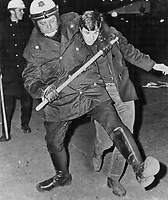 1969 FILE PHOTO - ARCHIVES -<br /> <br /> Clamped In A Headlock by a Montreal policeman who uses a threefoot riot baton to reinforce his grip; a demonstrator is hauled away last night during protest march on McGill University by 6;000 French-Canadian youths.<br /> <br /> 1969<br /> <br /> PHOTO : Boris Spremo - Toronto Star Archives - AQP
