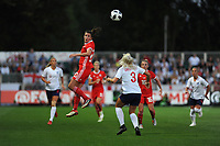 Helen Ward of Wales Women vies for possession with Alex Greenwood of England Women during the FIFA Women's World Cup Qualifier match between Wales and England at Rodney Parade on August 31, 2018 in Newport, Wales.
