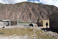 A Tibetan man walks through a relocation town in Zaduo, in the far interior of the Tibetan Plateau, in western China. Relocation communities been created to house nomadic herders moved from the highland grasslands. The nomads have been blamed for contributing to the deterioration of the grasslands, so have been moved, sometimes forcibly, into newly built towns that can be found across the plateau.