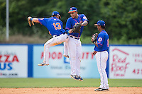 (L-R) Arnaldo Berrios (13), Hengelbert Rojas (33) and Luis Carpio (11) celebrate their win over the Greeneville Astros at Hunter Wright Stadium on July 7, 2015 in Kingsport, Tennessee.  The Mets defeated the Astros 6-4. (Brian Westerholt/Four Seam Images)