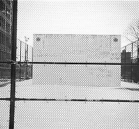 Hand ball court behind fence&#xA;<br />