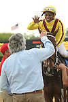 HOT SPRINGS, AR - APRIL 9: Jockey Ricardo Santana, Jr. aboard Terra Promessa #2 , giving trainer Steven Asmussen a high five after winning the Fantasy Stakes at Oaklawn Park on April 9, 2016 in Hot Springs, Arkansas. (Photo by Justin Manning/Elipse Sportwire/Getty Images)