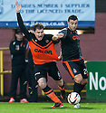 Dundee Utd's Paul Paton is pulled back by Killie's Alexei Eremenko.