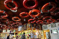 GERMANY Hamburg, Filipino seaman in seaman´s club Duckdalben, bar with rescue rings / DEUTSCHLAND Hamburg , Seemannsclub Duckdalben eine soziale Einrichtung der Diakonie fuer Betreuung von Seeleuten, Bar mit Rettungsringen