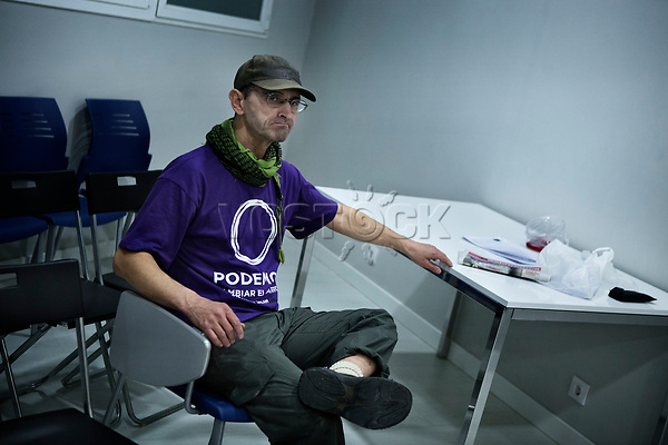 Madrid, Spain, February 12, 2015. A member of the left wing [party] Podemos waits for the beginning of their weekly meeting in Salamanca's neighbourhood in Madrid.