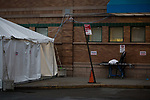 A stretcher stands next to a triage tent outside of the emergency room at Maimonides Medical Center on March 28, 2020 in Brooklyn, NY.  NYC's daily death toll from the coronavirus nearly tripled from the previous 24-hour period from 85 on Friday to 222 on Saturday.  Photograph by Michael Nagle/Redux