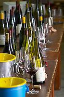 bottles glasses spittoons in the cellar tasting room dom a voge cornas rhone france