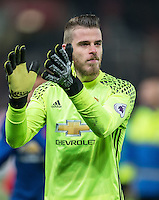 Goalkeeper David De Gea of Manchester United applauds the support after the Premier League match between Stoke City and Man Utd at the Britannia Stadium, Stoke-on-Trent, England on 21 January 2017. Photo by Andy Rowland.